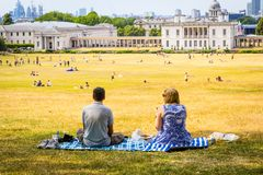 A couple relaxing on a hot, sunny day on Primrose Hill in London, UK. A couple relaxing on a hot, sunny day on Primrose Hill in London, United Kingdom stock photography