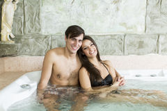 Couple relaxing in the hot tub Royalty Free Stock Photo
