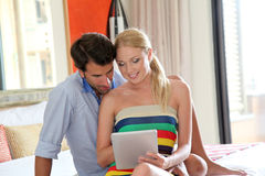 Couple relaxing in hotel room Royalty Free Stock Photography