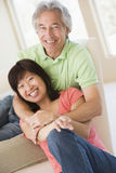 Couple relaxing indoors and smiling Royalty Free Stock Photos