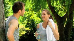 Couple relaxing after jogging Royalty Free Stock Image