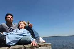 Couple relaxing by the lake Royalty Free Stock Images