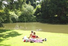 Couple relaxing at lakeside Stock Photos