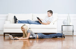 Couple Relaxing in Living Room Royalty Free Stock Photos