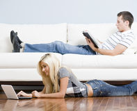 Couple Relaxing in Living Room Royalty Free Stock Image