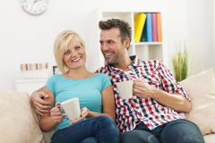 Couple relaxing in living room Stock Image