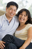 Couple relaxing in living room and smiling Stock Photo