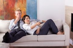 Couple relaxing after long day. In front of tv Royalty Free Stock Photo