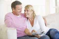 Couple relaxing with a magazine and smiling Stock Photo