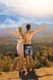 Couple relaxing in mountains Stock Photos