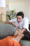 Couple relaxing on moving day Royalty Free Stock Images