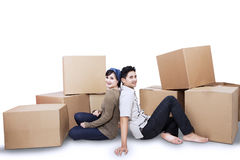 Couple relaxing moving into a new home  Royalty Free Stock Photography