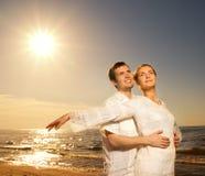 Couple relaxing near the sea Stock Photo