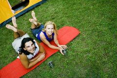 Couple relaxing near tent Royalty Free Stock Photos