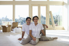 Couple relaxing in new home royalty free stock photos