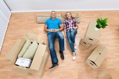 Couple Relaxing At New Home Royalty Free Stock Photos