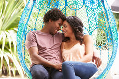 Couple Relaxing On Outdoor Garden Swing Seat Royalty Free Stock Images