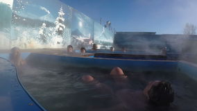 Couple relaxing in outdoor geothermal spa having balneological properties stock video footage