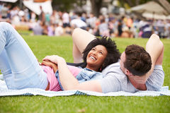 Couple Relaxing At Outdoor Summer Event Royalty Free Stock Images