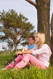 Couple relaxing outdoors. In park Stock Photo