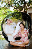 Couple Relaxing Outdoors Stock Images