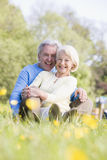 Couple relaxing outdoors smiling Royalty Free Stock Photo