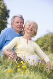 Couple relaxing outdoors smiling Stock Photo