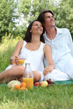 Couple relaxing outside Stock Images