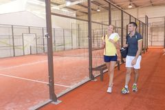 Couple relaxing after paddle tennis match Stock Images