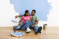 Couple relaxing while painting. Stock Photo