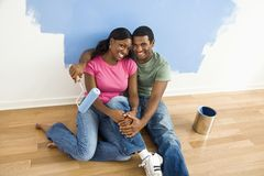 Couple relaxing while painting. Stock Image