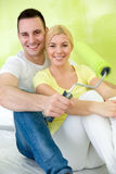 Couple relaxing after painting Stock Images