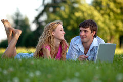 A couple relaxing in the park Stock Image