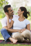 Couple relaxing in park. Sitting on blanket Stock Photography