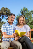 Couple relaxing in the park on bench Royalty Free Stock Photography