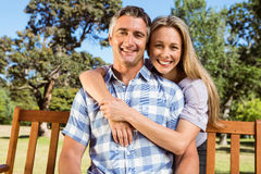 Couple relaxing in the park on bench Royalty Free Stock Photos