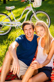 Couple relaxing in park. stock image