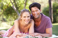 Couple Relaxing In Park Together Stock Photos