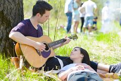 Couple Relaxing at Picnic Royalty Free Stock Images