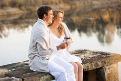 Couple relaxing pier Royalty Free Stock Image