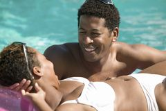 Couple Relaxing in pool Royalty Free Stock Images
