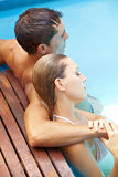 Couple relaxing in pool Royalty Free Stock Photo