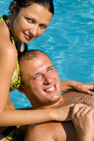 Couple relaxing by the pool Stock Image