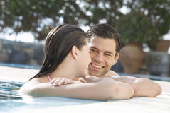 A couple relaxing in a pool Royalty Free Stock Image