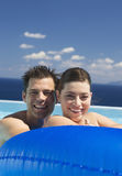 A couple relaxing in a pool Royalty Free Stock Photo