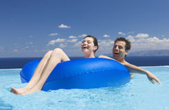 A couple relaxing in a pool Stock Photo