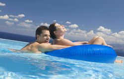A couple relaxing in a pool Stock Image