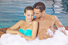 Couple relaxing in pool of hotel Stock Image