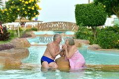 Couple relaxing at pool Royalty Free Stock Photo