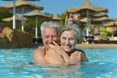 Couple relaxing at pool Royalty Free Stock Images